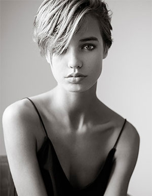 model with short hair and  wavy side bangs