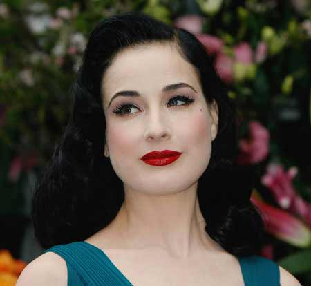 Dita Von Teese with her signature look and beautiful black hair color and bold red lips