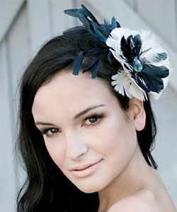 Feather Fascinator from designer Tessa Kim example with feathers and an  onyx jewel dea3b884fb6