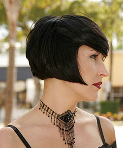 black hair color above chin haircut in classic bob profile view