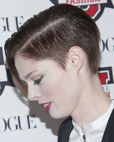 coco rocha with short hair cut on sides and tapered back