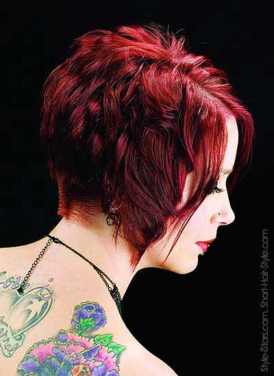 a diagonal haircut in red violet - side view