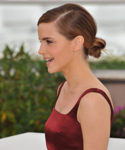 Emma Watson profile view with her hair in a simple bun