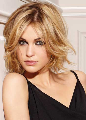 mid-length layered hair cut with bright golden blonde highlight