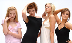 several models with different hair colors of red, blond and black