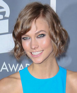 Karlie Kloss with short bob haircut in wavy style