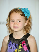 little girl with curly hair decorated with a headband