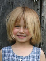 little girl with short messy bob style