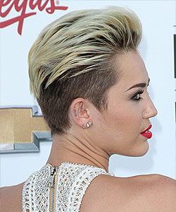 Miley Cyrus in May 2013 with bleached blond on top and dark on sides creating contrast look