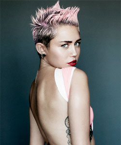Miley with punky short hair and faded pink dip dye color