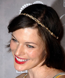Milla Jovovich with golden metal chain headband
