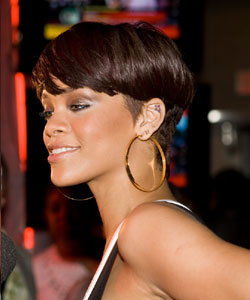 Rihanna with partial bowl haircut side view