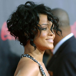 Rihanna with short curly hair