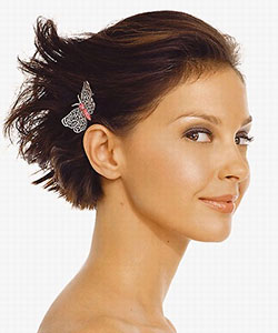 Ashley Judd with butterfly hair accessories on short hair