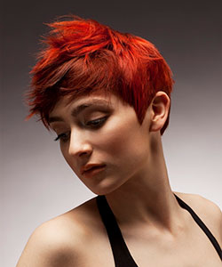 short hair with bright red orange peek-a-boo effect on earthly brown - side view