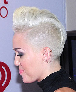 Miley Cyrus with same mohawk haircut in overall silver color