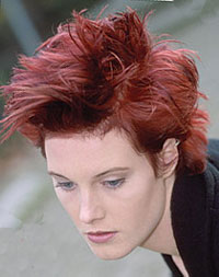 short hair model with spiky texture and violet red hair color