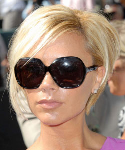 Victoria Beckham with chin-length bob in blonde wearing sun glasses