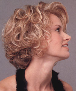 model with short curly hair side view left