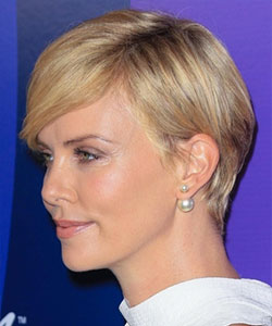 charlize theron with grown pixie cut profile view