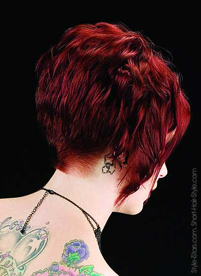 model with a diagonal haircut back view with beautiful tatoo
