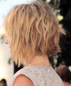 Dianna Agron's haircut with wavy bob and shag crossed hairstyle in back view