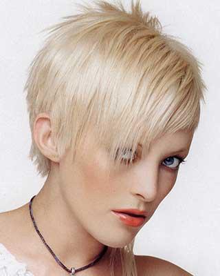 asymmetric razor hair cut in platinum blond
