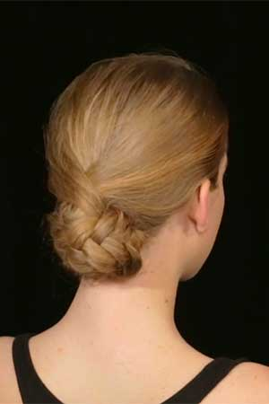 an updo created by a fishtail braided ponytail