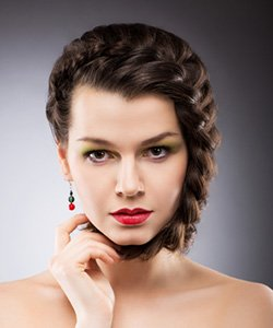 Model with braided hair on front section and bangs area