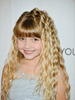 little girl with long crimped wavy hair