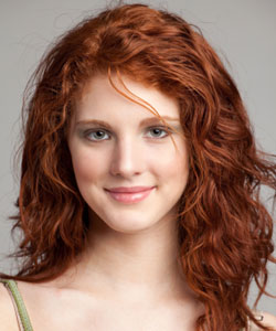 model with wavy long hair and red hair color