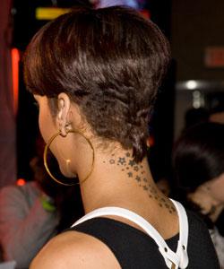 Rihanna with partial bowl haircut back view