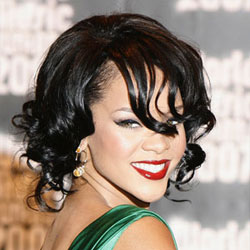 Rihanna curly hairstyle bold red lips