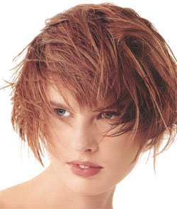 short hair model with tousle style and red hair color