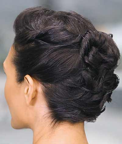 hair styled into an twist back updo with bobby pin - after