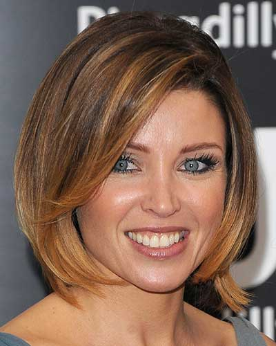Bob haircut with soft side bangs and face framing highlights