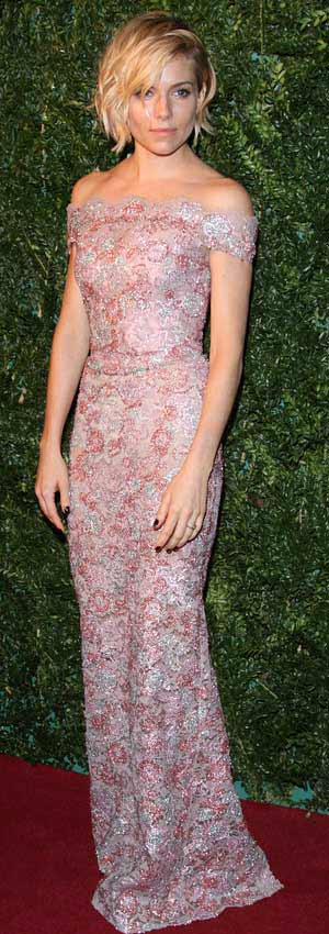 Sienna wore this rose-colored Burberry dress with silvery accents