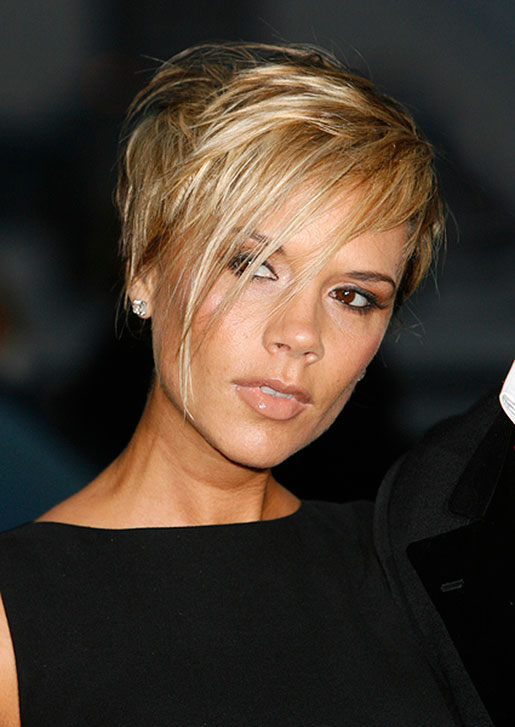 Victoria Beckham with short blond hair front view
