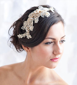 simple hairstyle in dark hair color decorated with gold lace headpiece