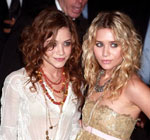 Mary and Ashely Olsen with curly hair style