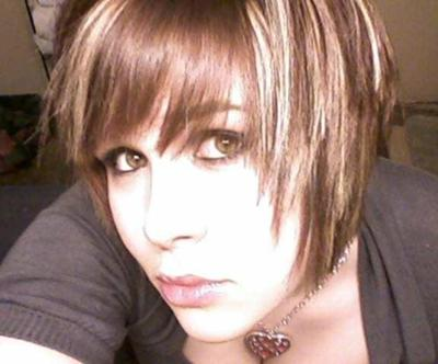 Great emo haircut with blonde streaks in dark brown hair. Short