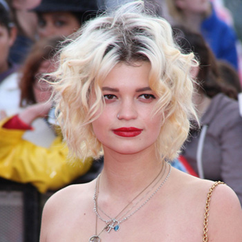 Pixie Geldof with short platinum blond and dark root