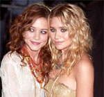 Mary and Ashley Olsen with wavy and curly hair